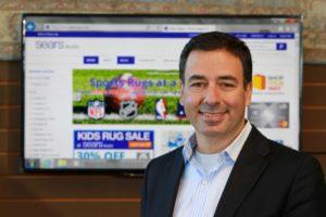 Amir Mireskandari in front of website